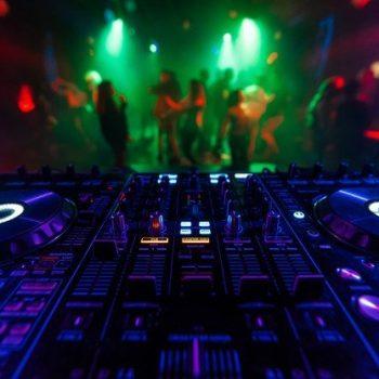 professional-dj-mixer-controller-mixing-music-nightclub_118086-1023
